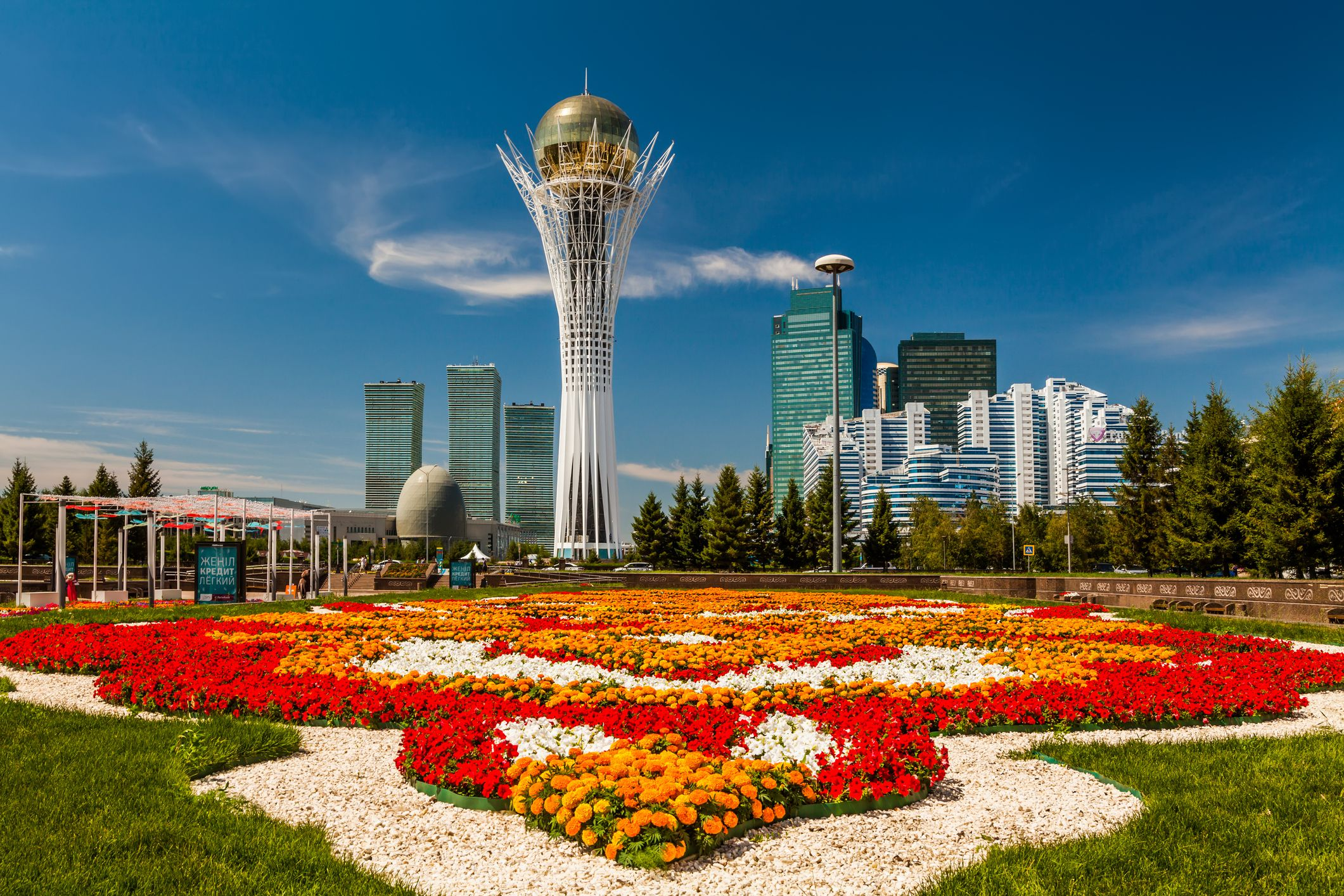 The Bayterek Tower is a Symbol of Kazakhstan The central boulevard, with flower beds leading up to Bayterek Tower