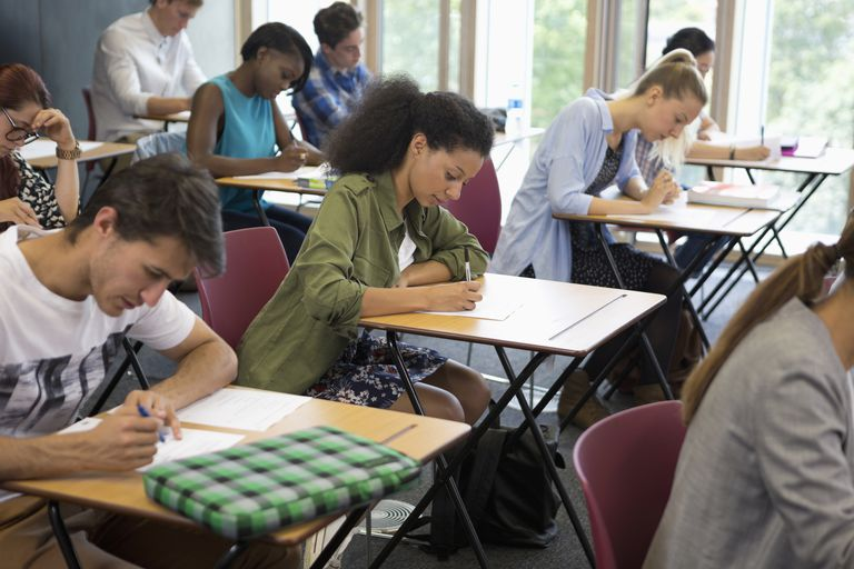 University students taking exam in classroom