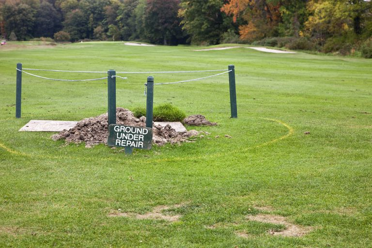 Ground under repair staked off in fairway on golf course