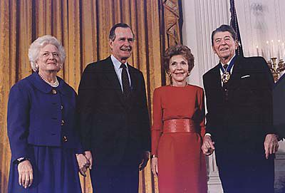 Picture of former President Ronald Reagan receiving the Medal of Freedom from President Bush.