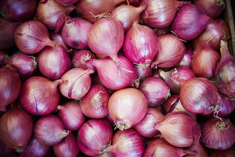 Full Frame Shot Of Onions In Market Stall