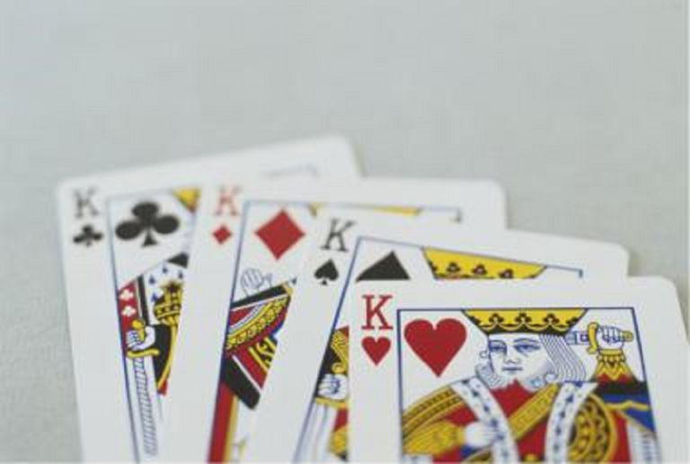 Four kings from deck of playing cards.