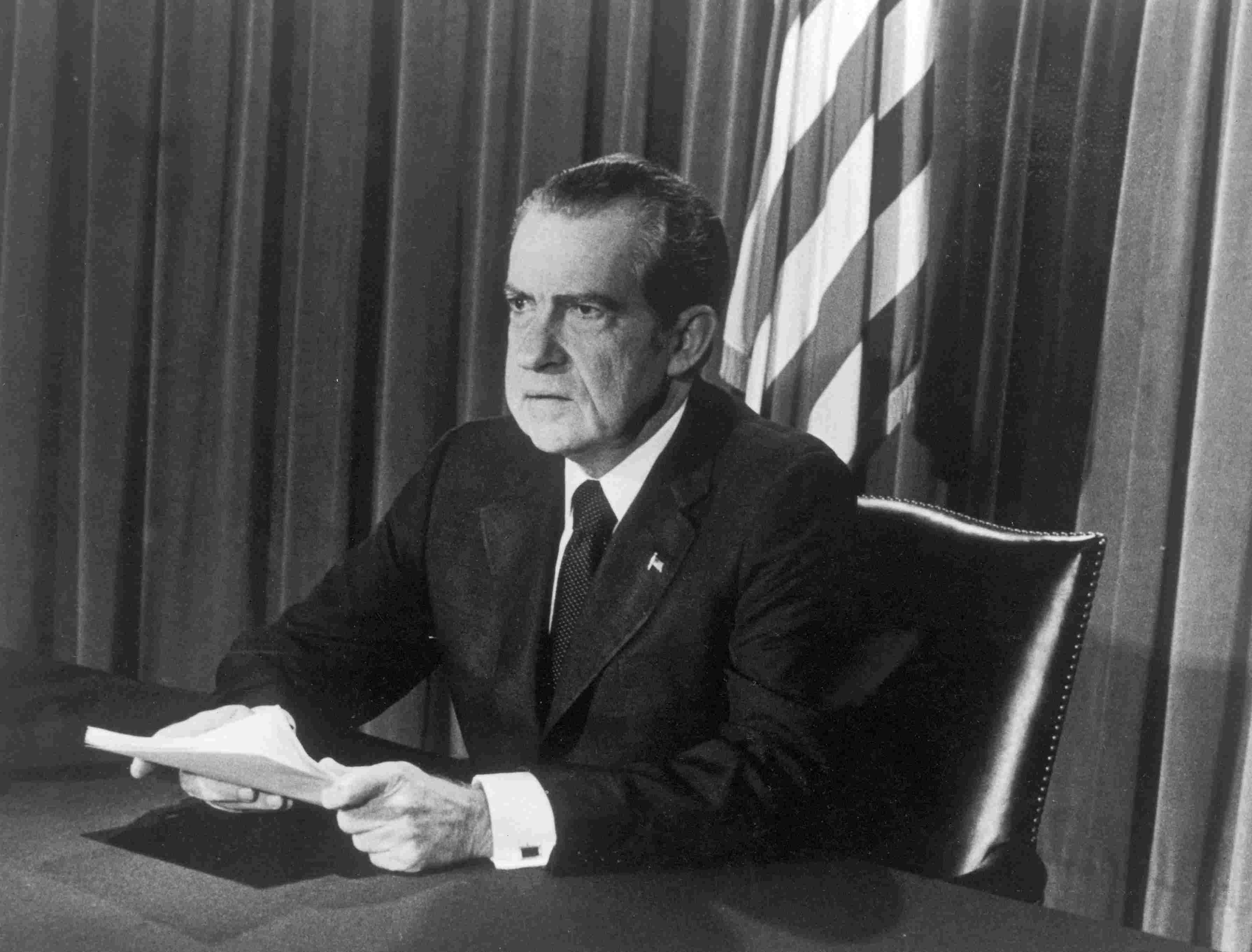 President Richard Nixon sits at his desk as he announces his resignation.