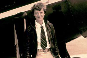 Amelia Earhart with plane, undated