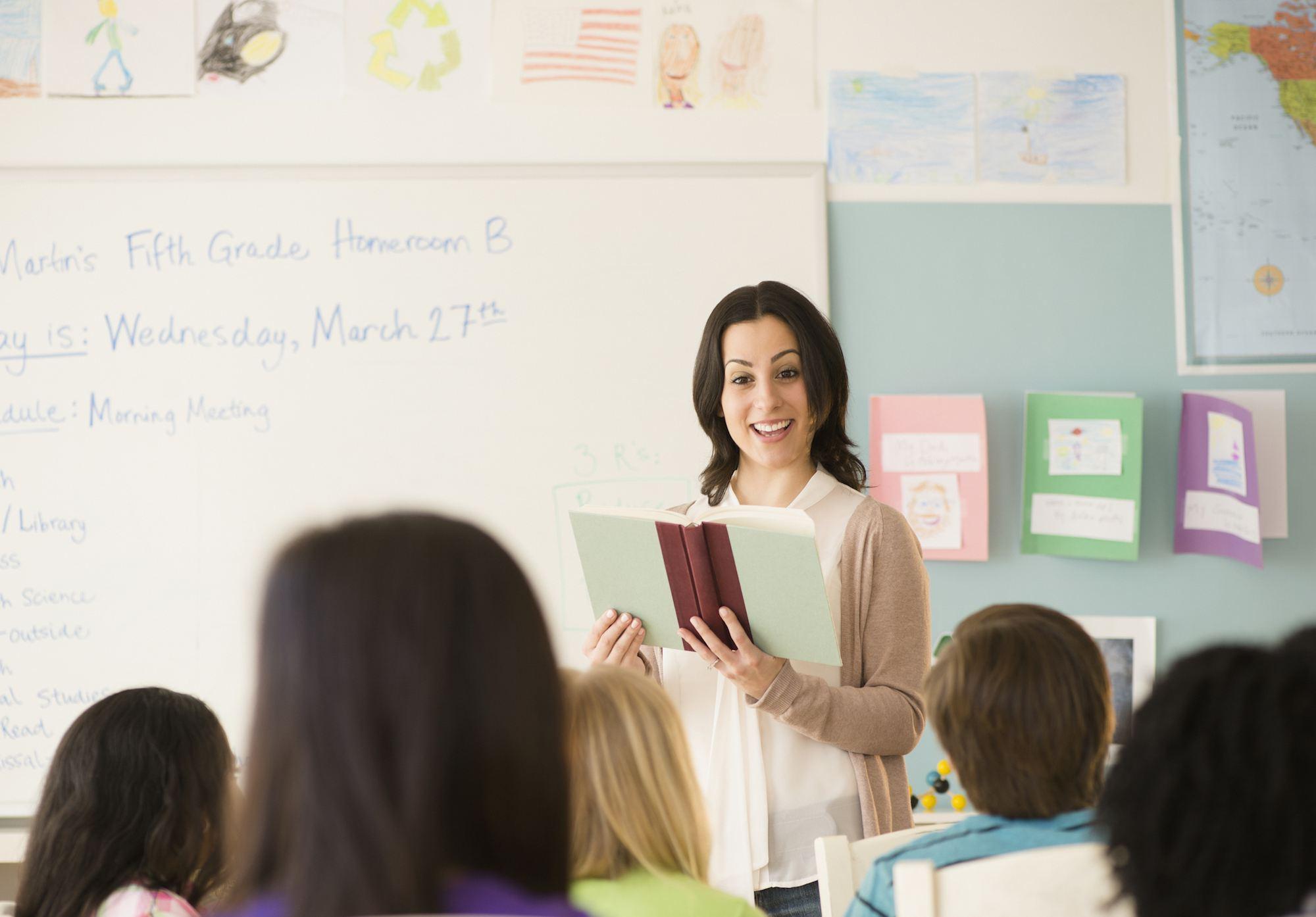 Teacher reading a book to class