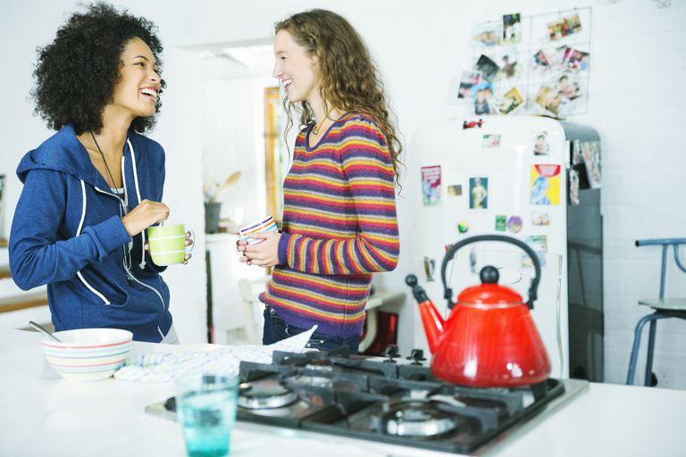 Women talking in kitchen