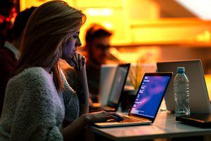 Woman Writing Code on Laptop