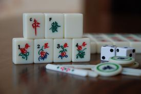 Mahjong tiles on a table facing the camera, full color photograph.