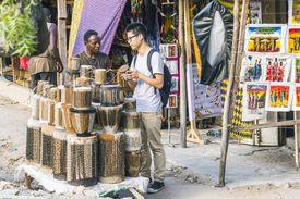 Tourist shopping at handicraft market, Mwenge, Dar-es-Salaam, Tanzania