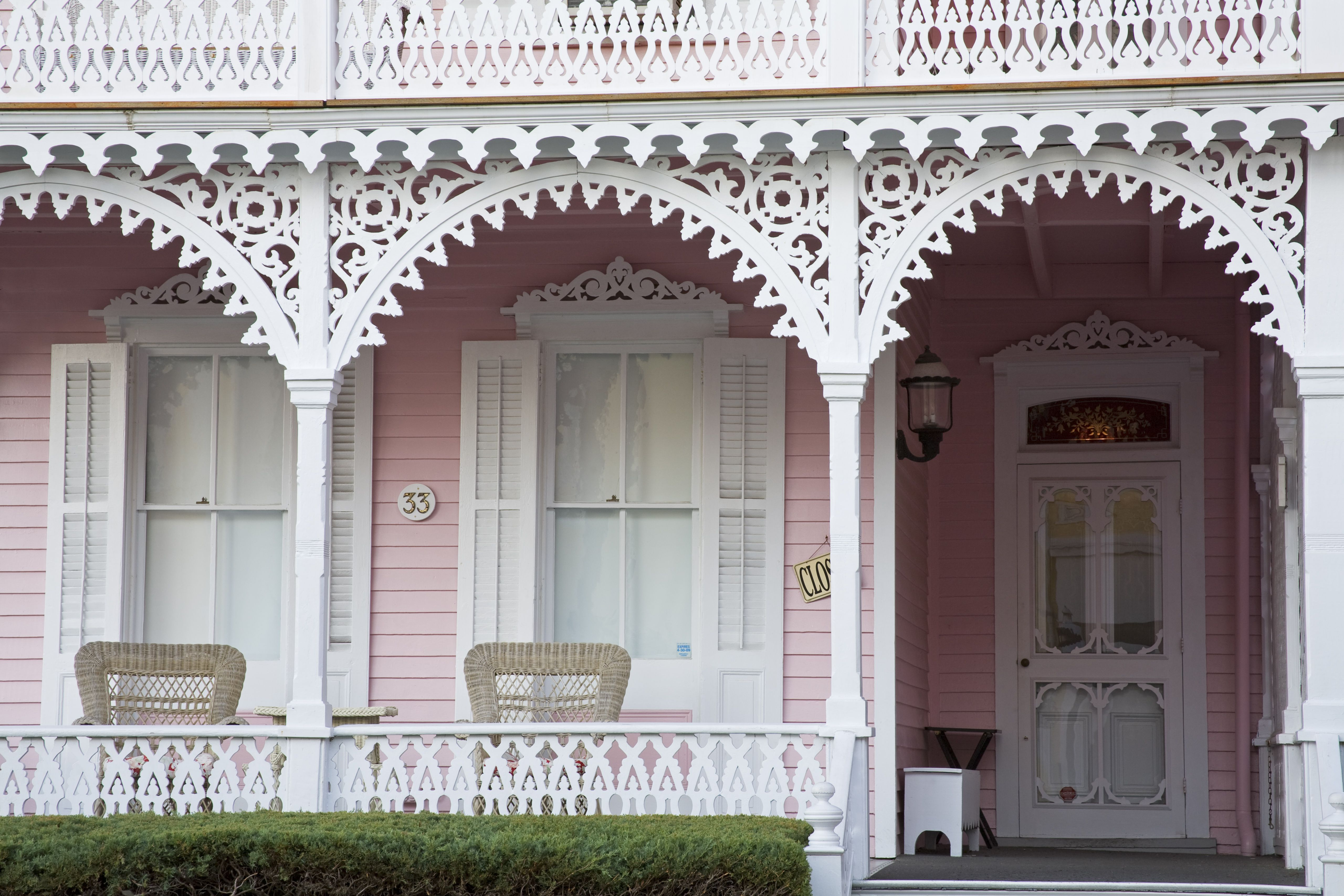Ornate Porch Detail In White Shutters Pink House Siding