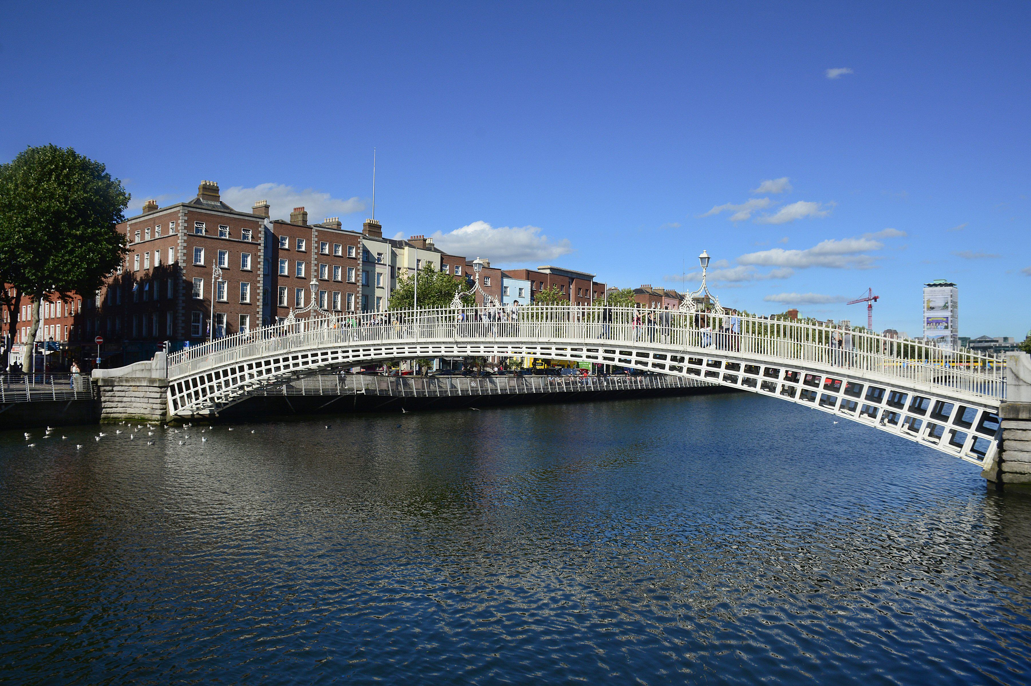 long, low arch of iron bridge over Liffey River in Dublin