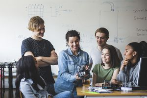 Teacher and students in a group setting