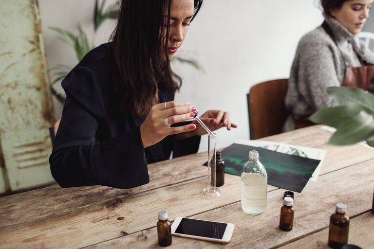 A woman making perfume