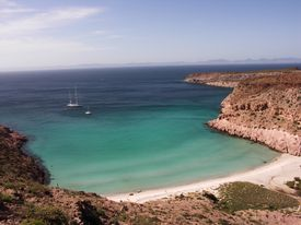 A beautiful bay in Baja, California on a sunny day with two boats on the blue water.