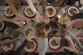 family toasting over Thanksgiving dinner