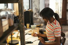 Young woman working at desk in a loft