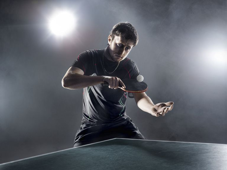 Caucasian male serving in table tennis