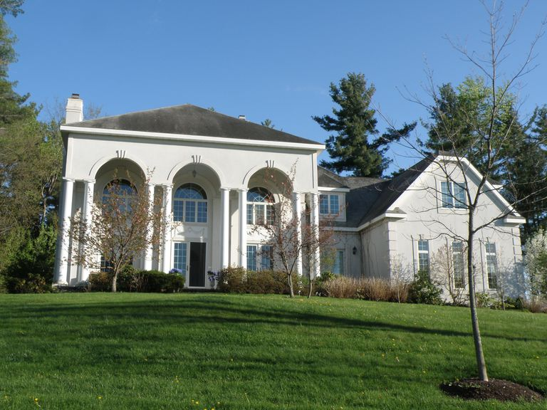 grand suburban home, a mix of styles, columns and arches, a variety of windows and roof styls