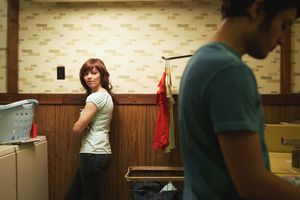 Woman Watching Man in laundry room