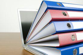 Ring binders on laptop