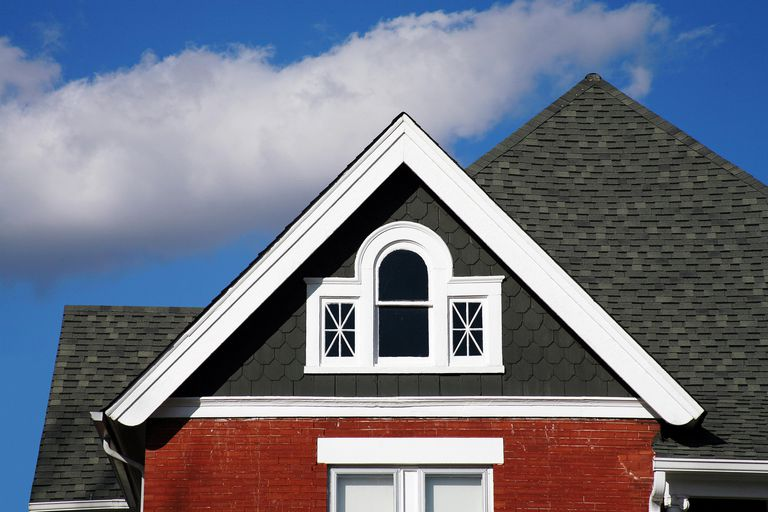 Houses of wood and brick may require different paints, dark wood gable atop red brick