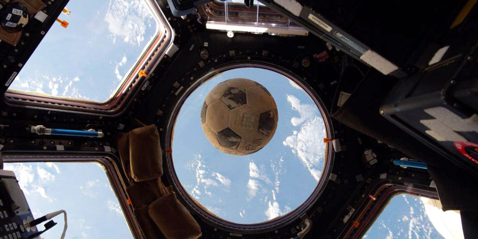 Ellison Onizuka's soccer ball, retrieved after the Challenger disaster, flies aboard the International Space Station during Expedition 49.