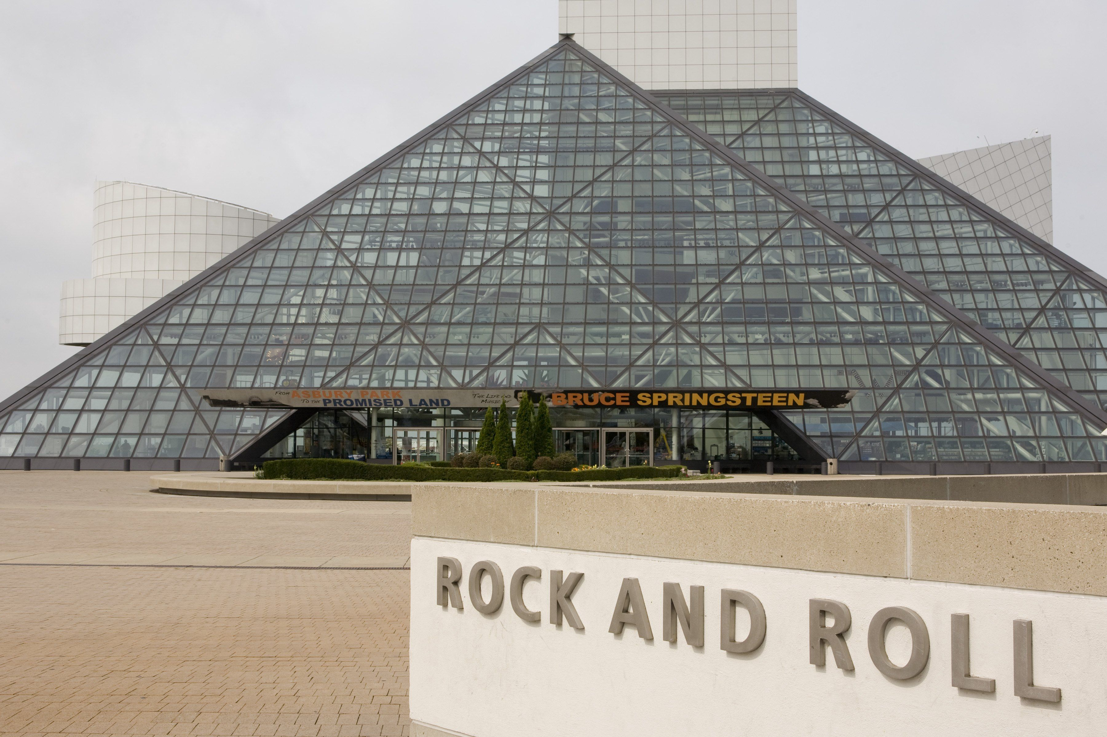 glass pyramid with sign in foreground: ROCK AND ROLL