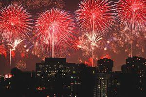 Fireworks in the sky behind buildings