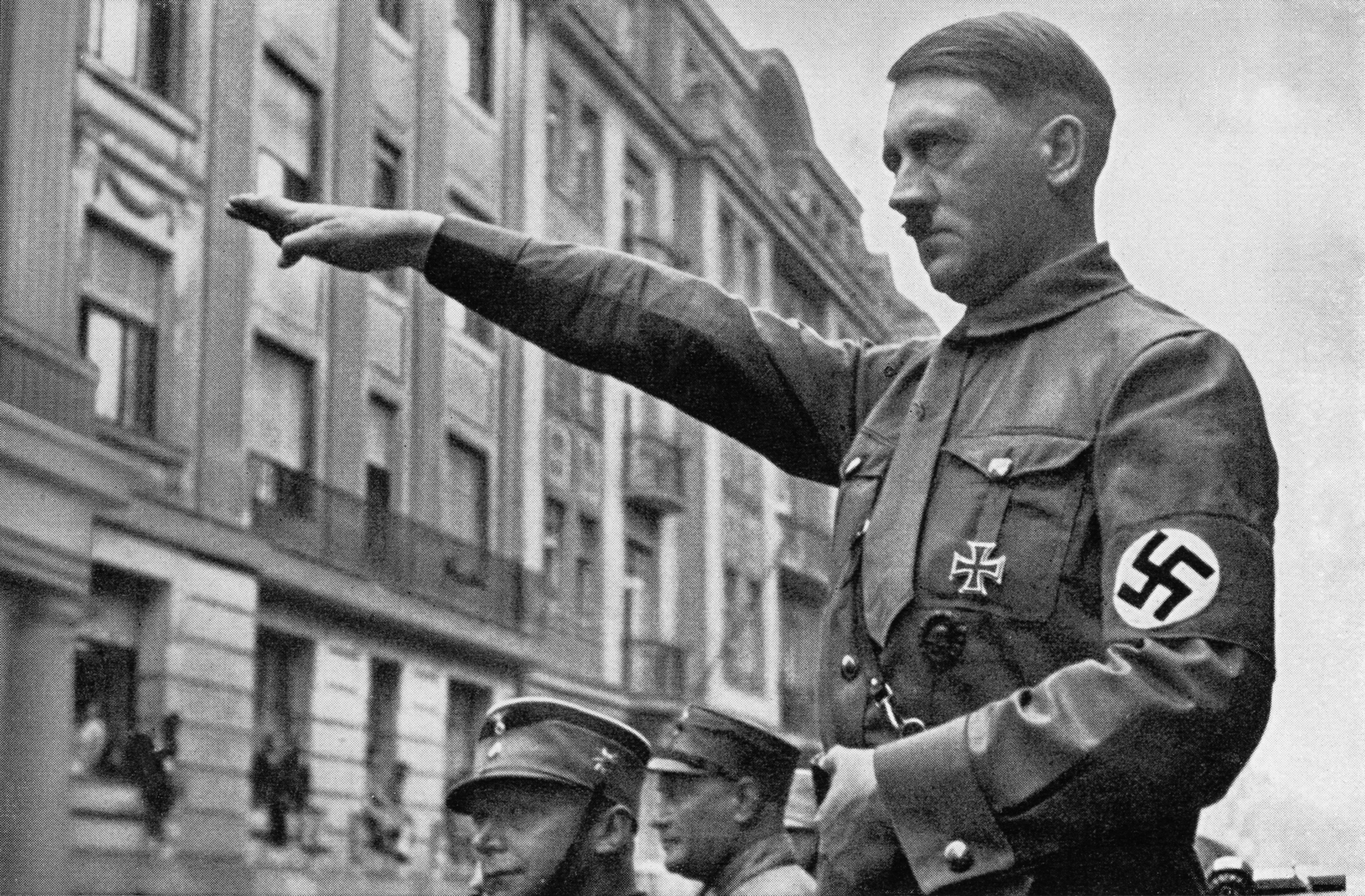 Adolf Hitler giving nazi solute to German soldiers.