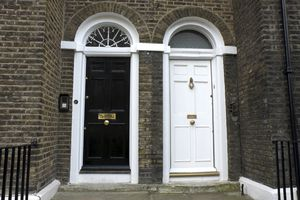 One black door next to one white door