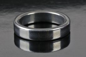 Close up of a platinum ring on a gray counter.