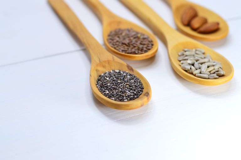 Wooden spoons holding an assortment of seeds.