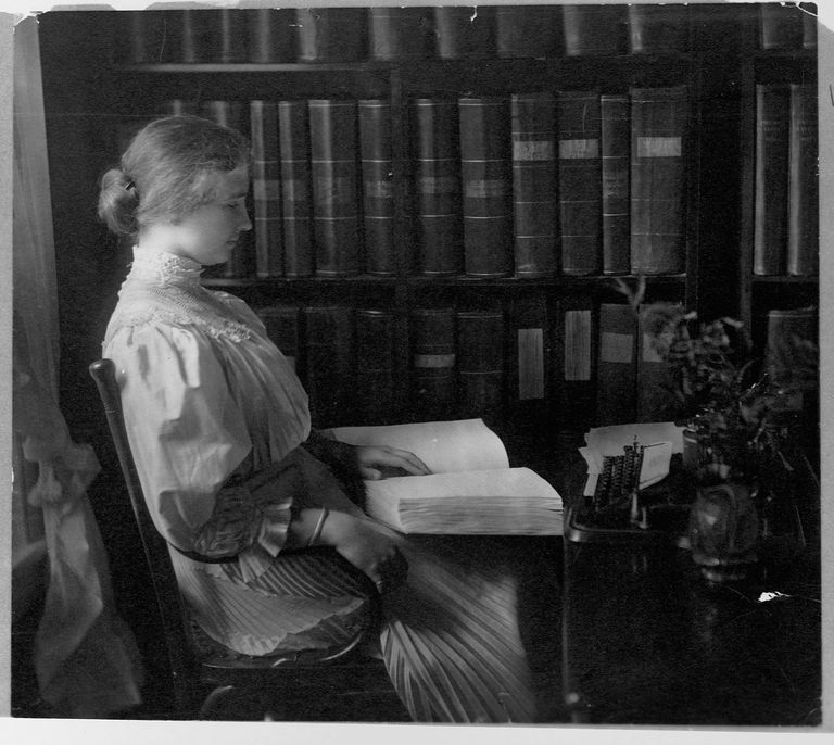 Writer Helen Keller Holding Braille Book in Study