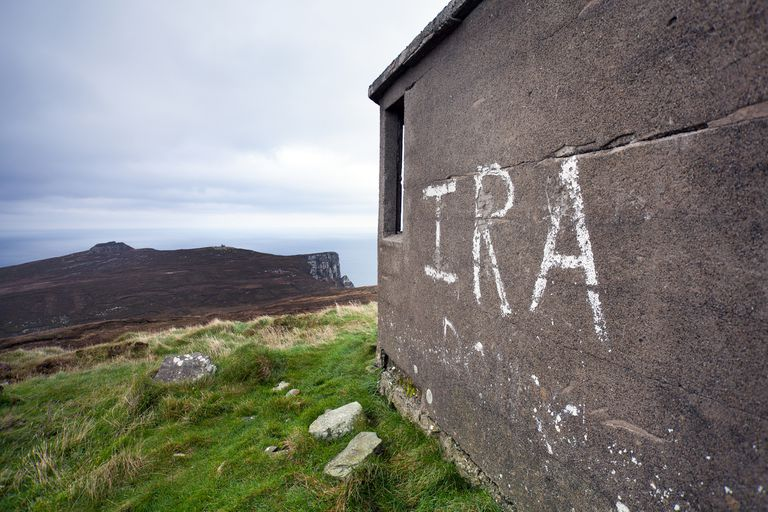 IRA graffiti on an old building near a cliff and the ocean