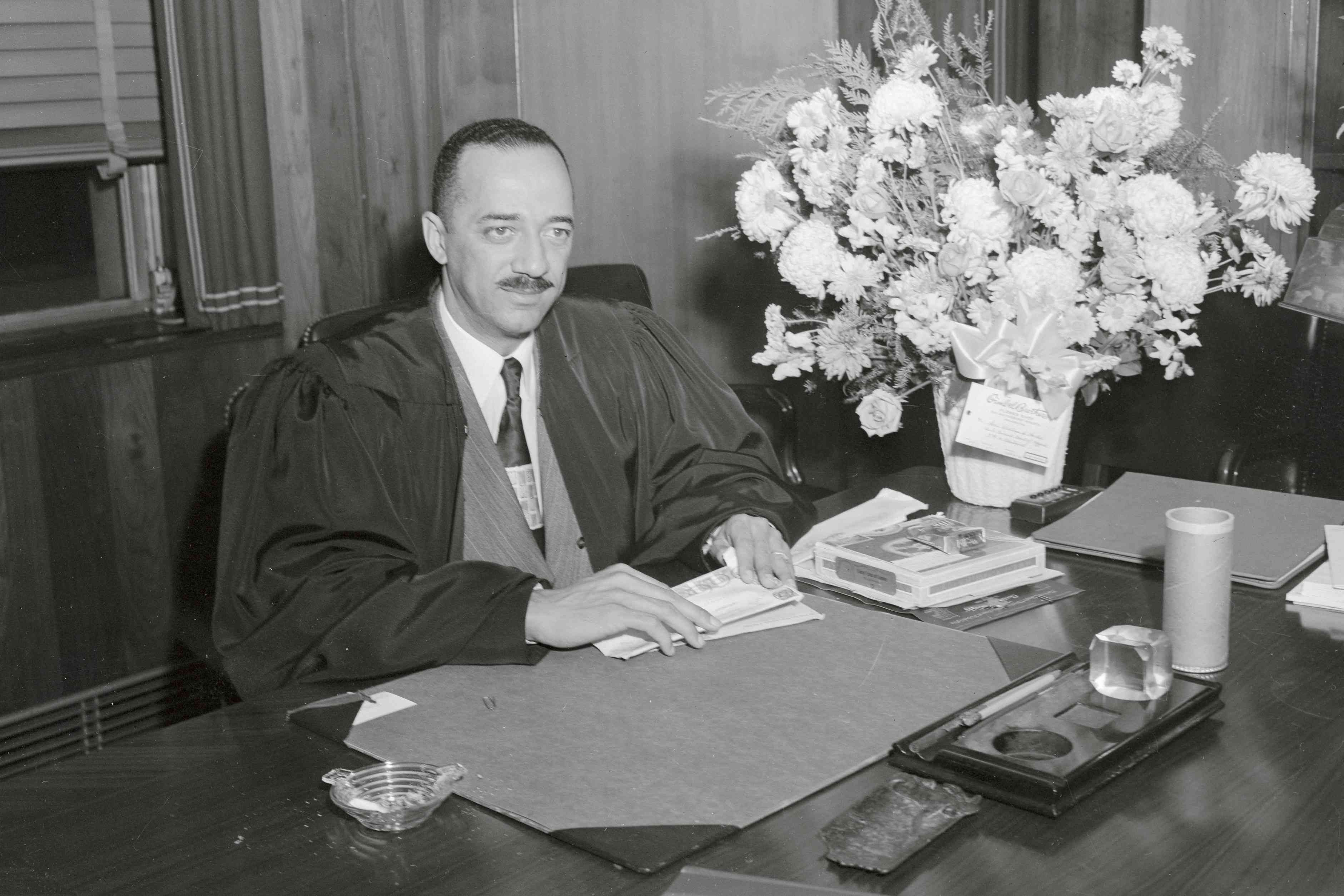 Judge William H. Hastie sits at his desk and works