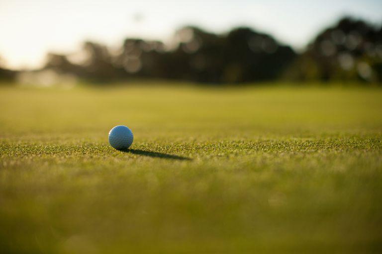 Golf ball sitting on the short grass