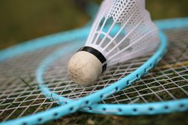 Close up of a badminton birdie and rackets