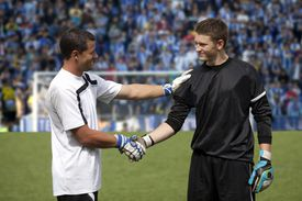soccer players shaking hands