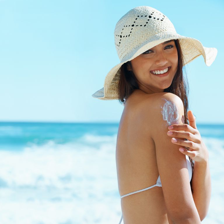 Woman applying natural sunscreen