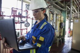 Female worker wearing hard hat