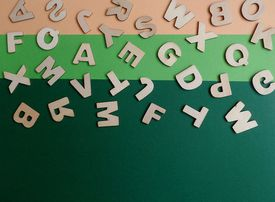 Letters scattered across a multi-color background.