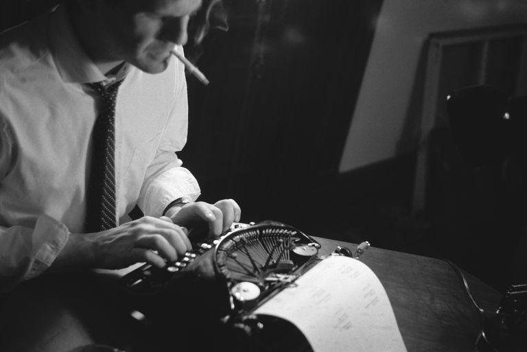 person at typewriter