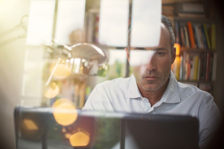 Businessman using laptop in home office