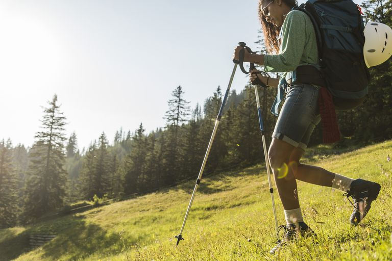 Young woman hiking on alpine meadow