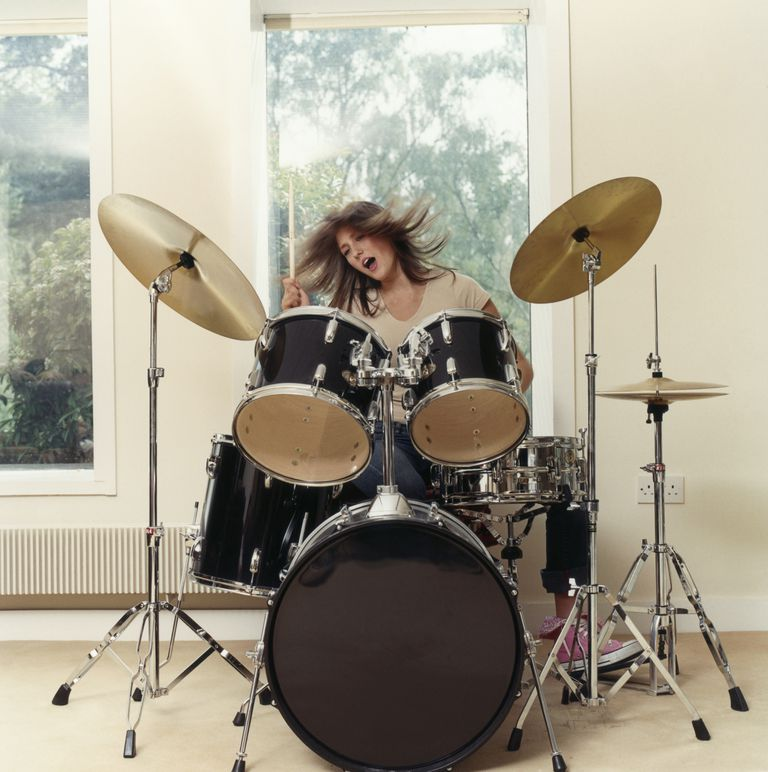 Woman Playing Drums