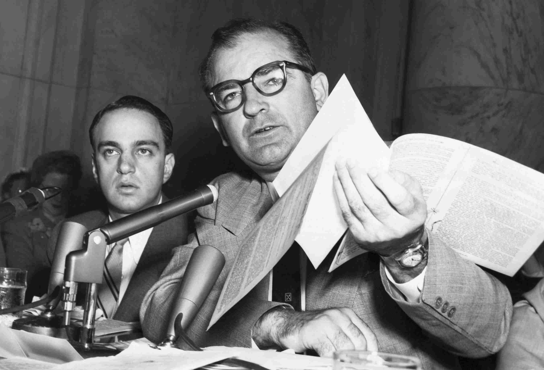Photo of Senator Joseph McCarthy holding papers.