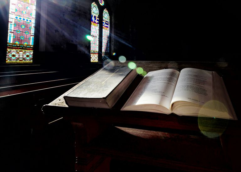 Sunlight Falling On Bibles In a Church.