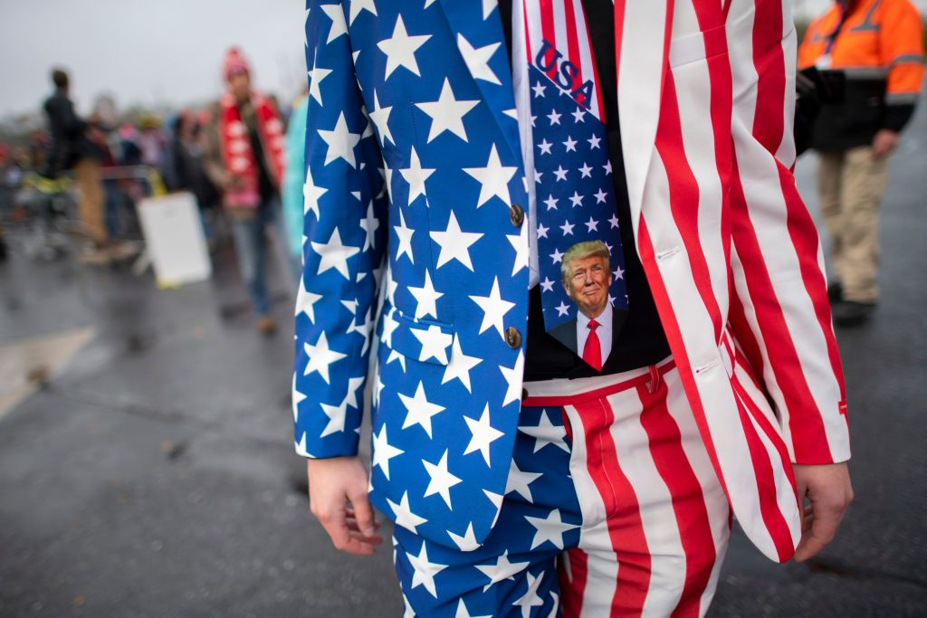A man wearing a Donald Trump themed tie joins supporters before President Donald Trump holds a rallyin Lititz, Pennsylvania.