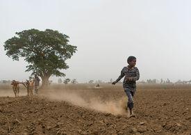 child running in dirt