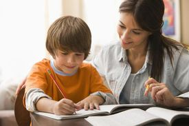 A picture of a mom homeschooling her son